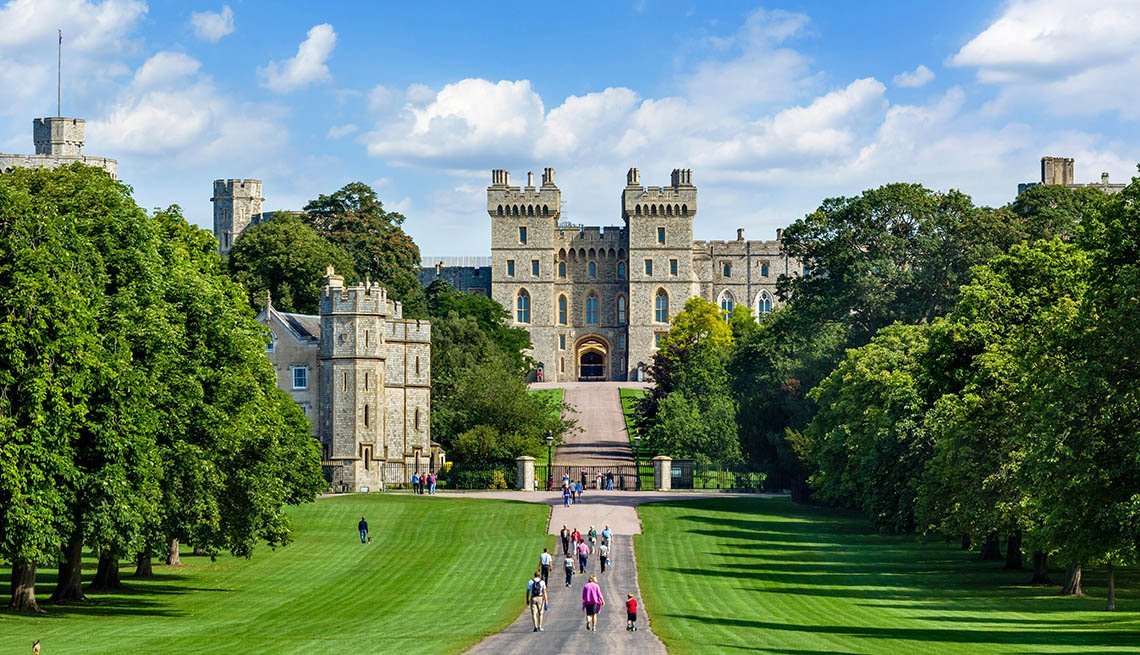 Tourists Walk Up Path And Through Windsor Park Up To Windsor Castle In England, World's Best Castles