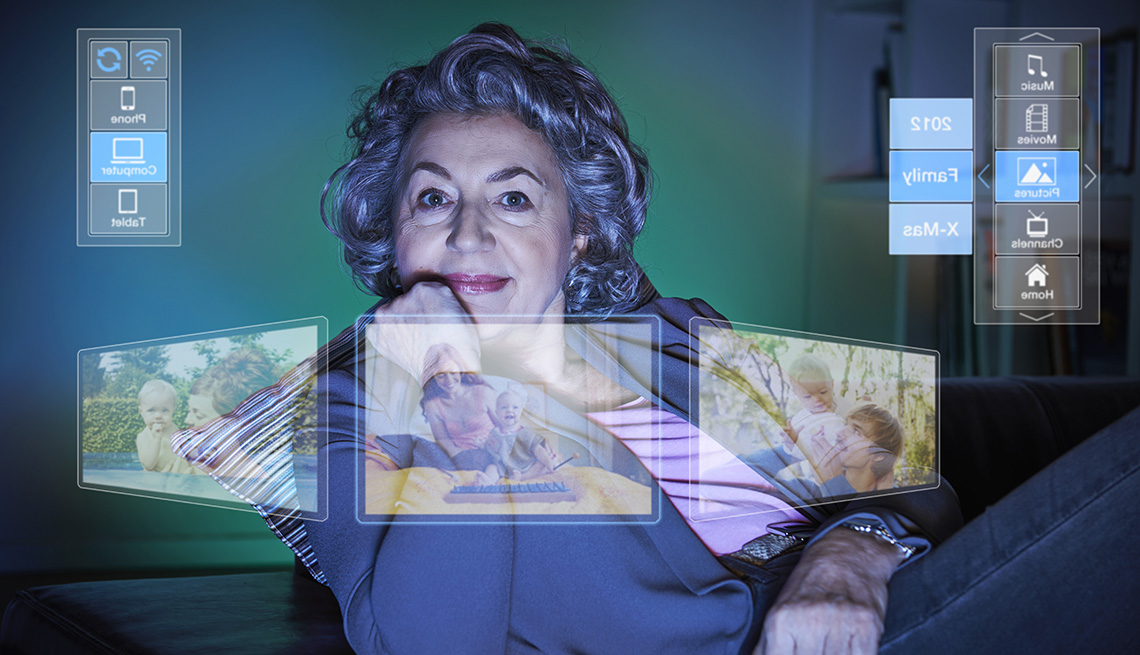 Middle Aged Caucasian Woman With Reflection From Computer On Her Face Of Her Online Custom Photo Album, Online Custom Photo Albums
