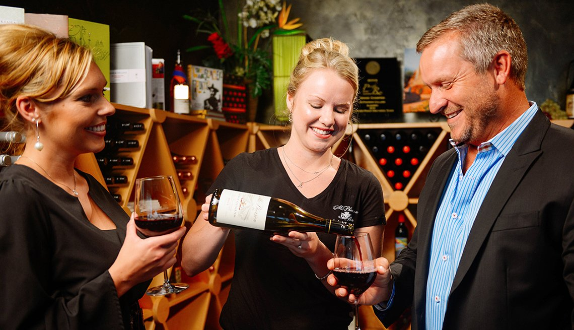 Caucasian Couple Are Assisted By Female Employee At Wine Tasting In Lubbock Texas, Travel Picks For 2017