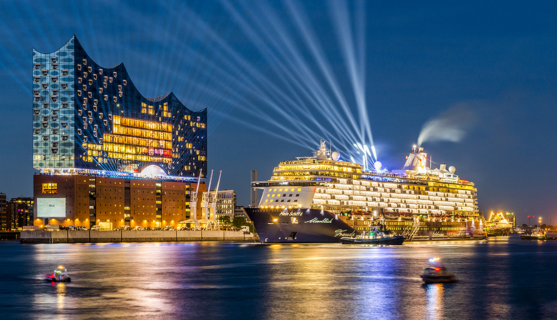 Cruise ship with bright lights in port at night