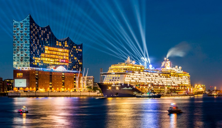 Cruise ship with bright lights in port