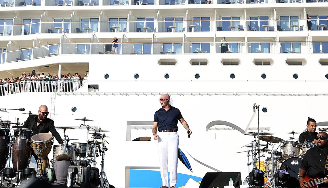 Musicians performing on a stage on the deck of a cruise ship