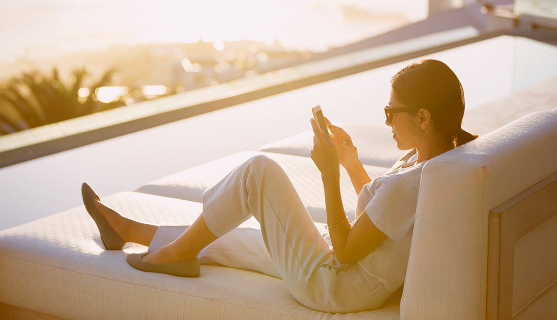 Woman using wifi at hotel pool