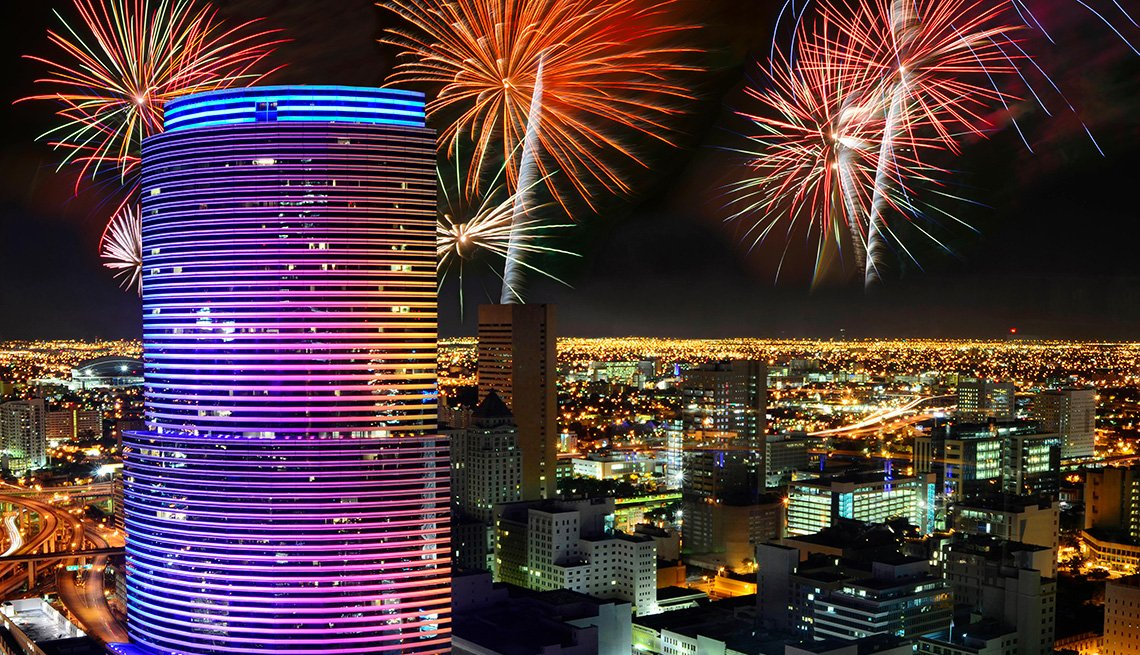 item 7 of Gallery image - View of the Miami skyline during a fireworks display.
