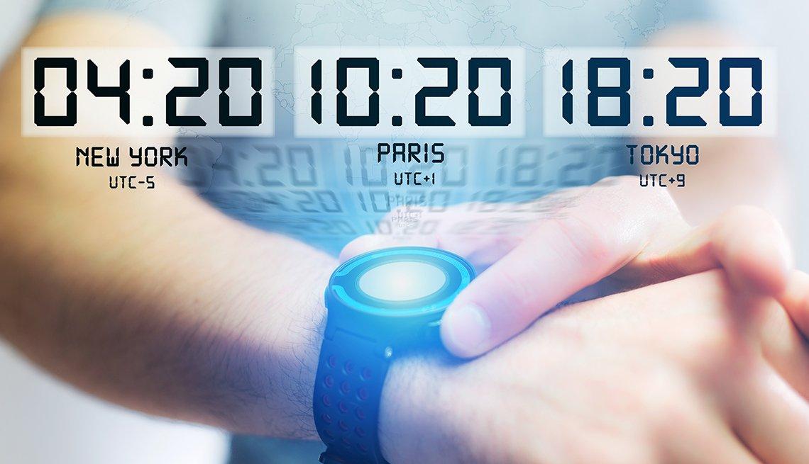 man using smart watch displaying various times