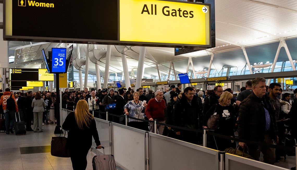 passengers in a long TSA line at JFK Airport