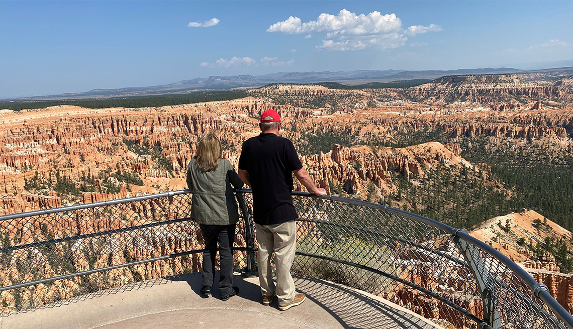 Tourists enjoy the view of the spire-shaped rock formations (hoodoos) in Bryce Canyon National Park, Utah