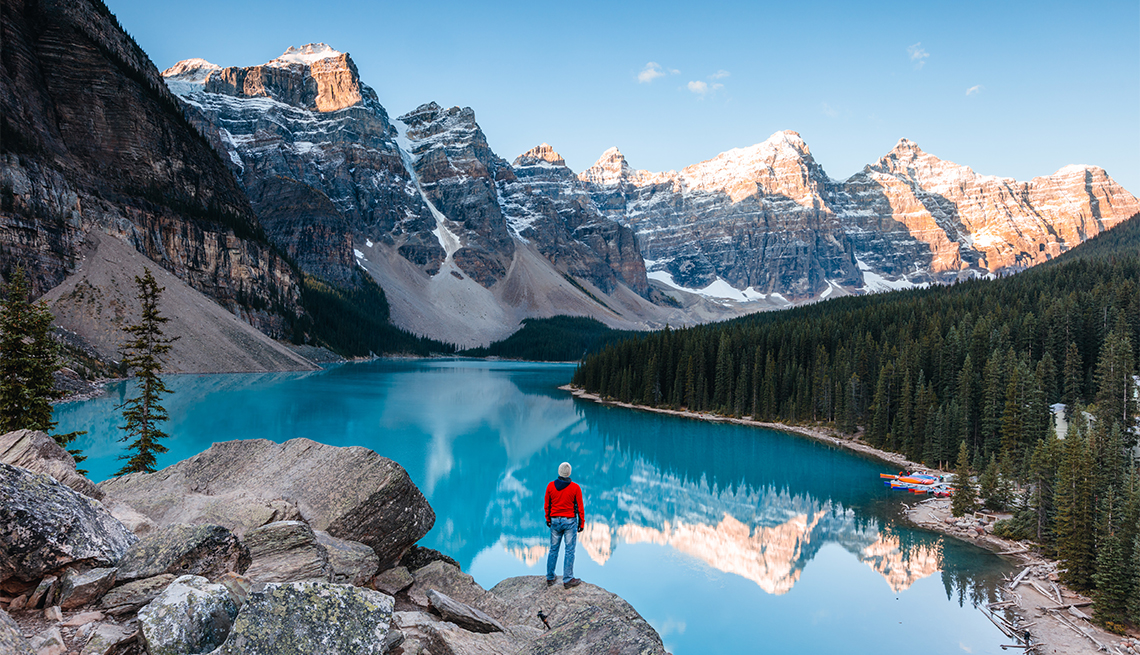 Man looking at Moraine lake at sunrise, Banff National Park