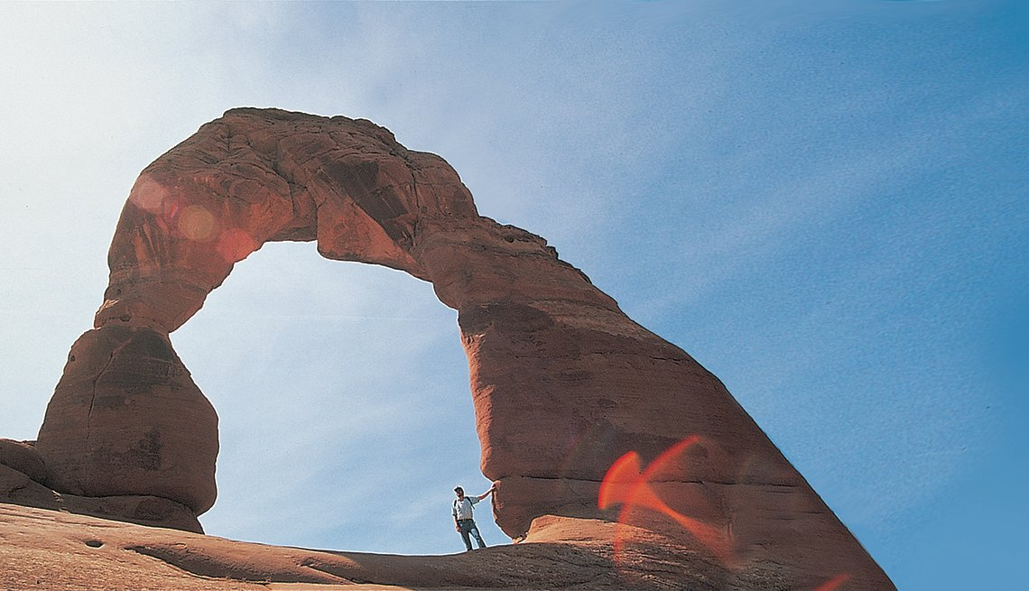 man standing at Arches National Park
