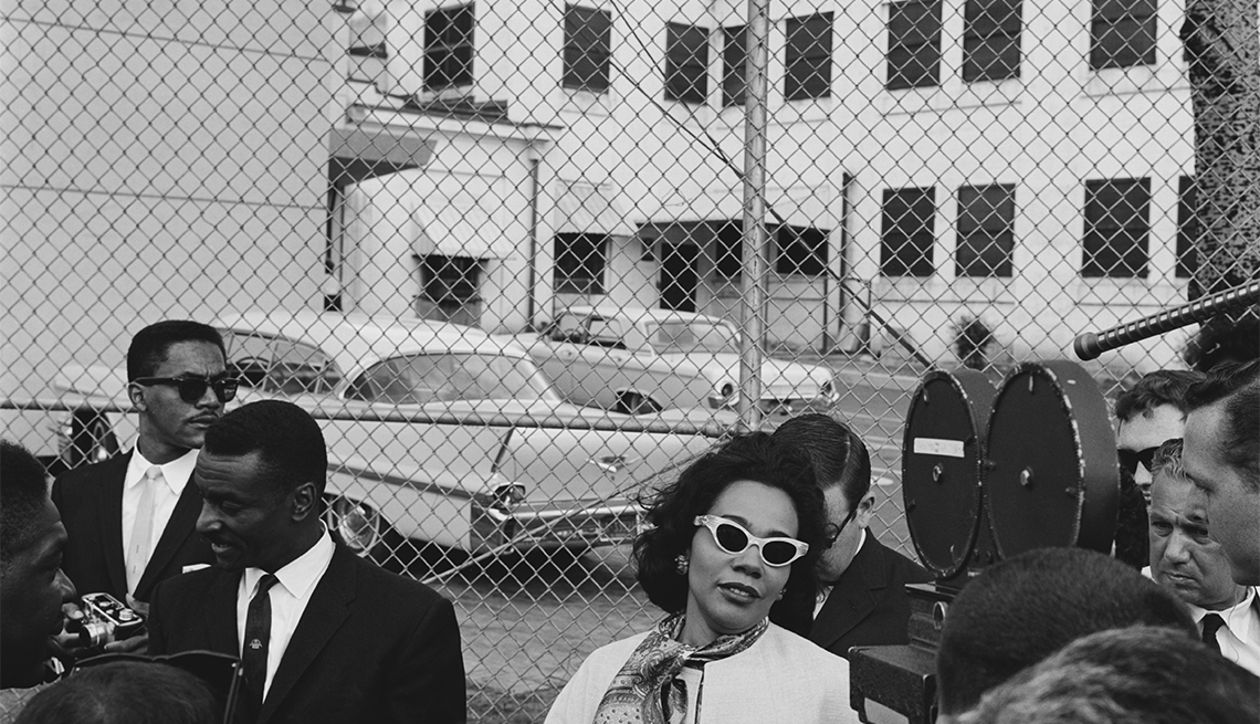 Coretta Scott King the wife of civil rights activist Martin Luther King Jr., with fellow activist Fred Shuttlesworth outside Birmingham City Jail, following her husband's arrest for his part in the Birmingham campaign, Alabama, April 1963