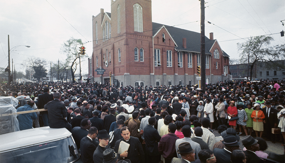 Thousands of funeral marchers gathered outside Ebenezer Baptist Church prepare to walk five miles to Morehouse College where another service for the slain Dr. Martin Luther King, Jr., will be held.