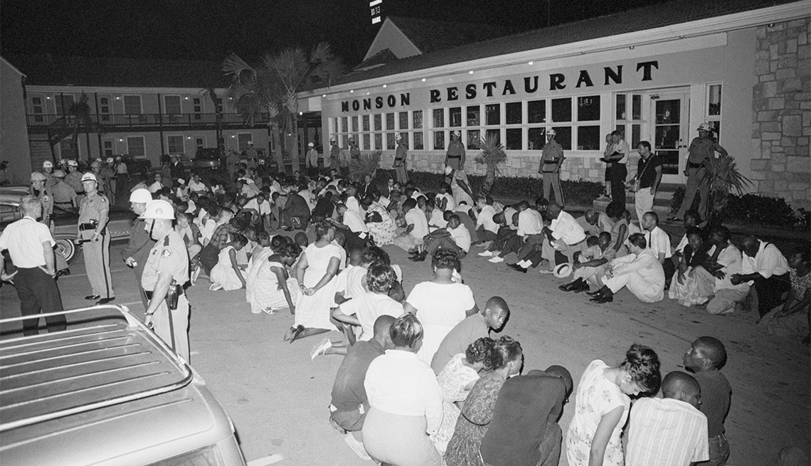 Demonstrators pray during a civil rights protest in the parking lot of the Monson Motor Lodge in Saint Augustine, Florida