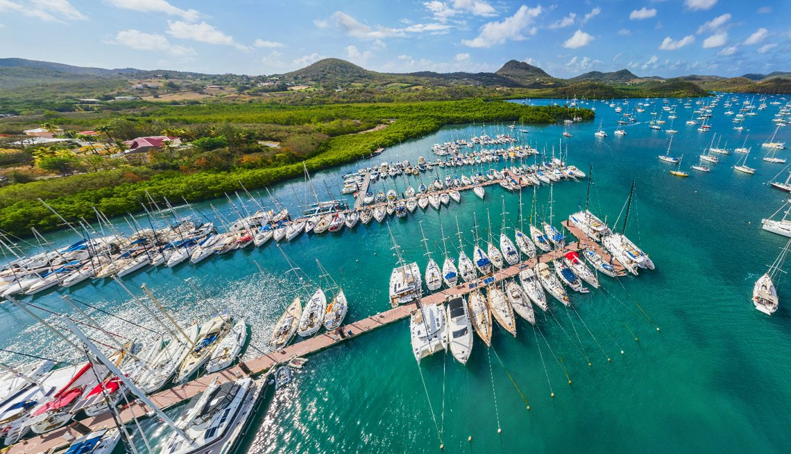 beautiful sunlit overhead photo of a boat filled harbor on the tropical island of martinique