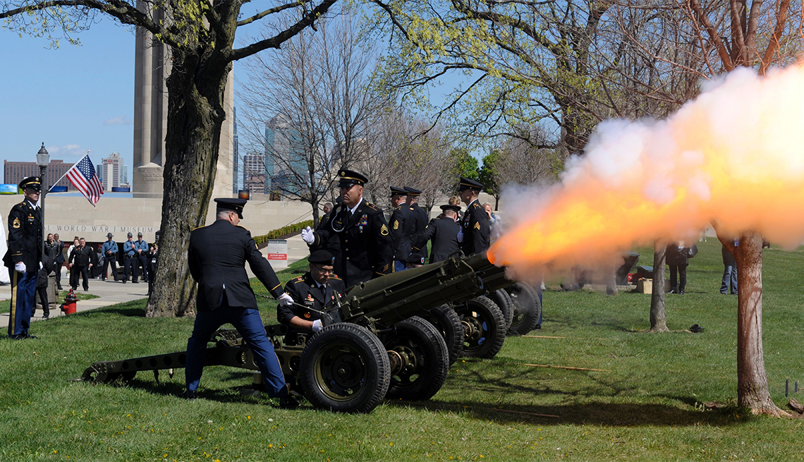 Members of the US Army's D Battery, First of the 129th Field Artillery unit, the same unit that President Harry S. Truman Commanded, fire a salute from their 75mm Howitzer during the centennial of the US entry into World War I at the National World War I