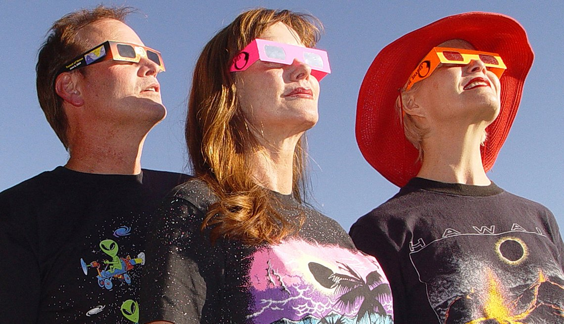 Three People Testing Eclipse Goggles