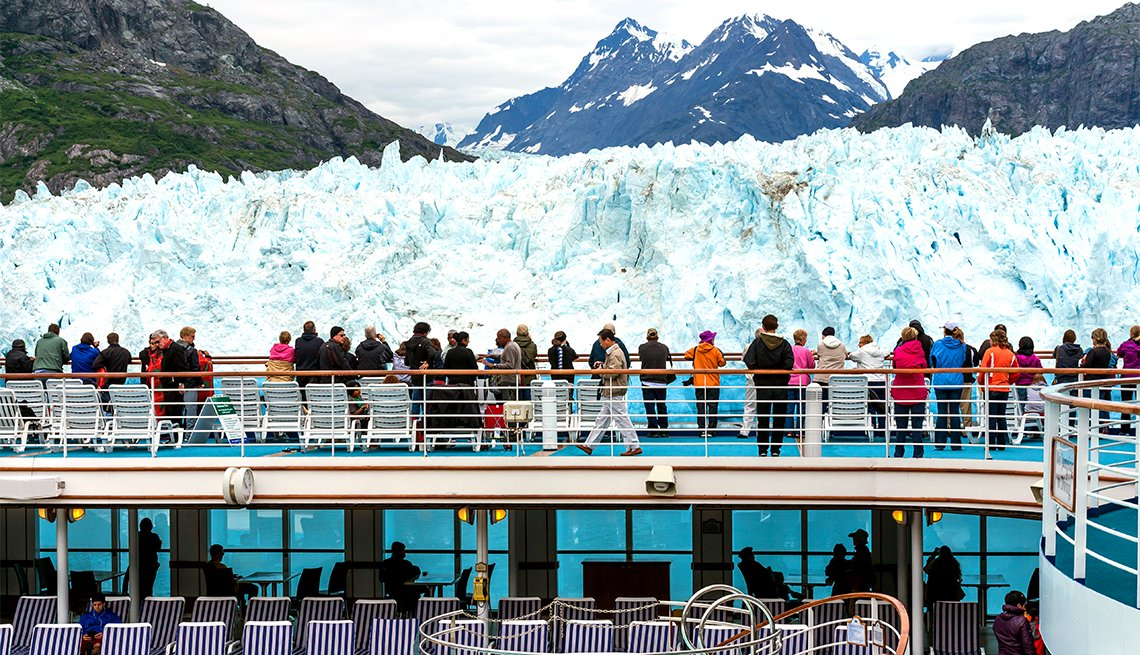 Tourists look at Margerie Glacier on the cruise ship