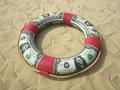 Consejos para determinar si necesita un seguro de viaje y cómo obtener la mejor oferta - Salvavidas envuelto en billetes de dólar