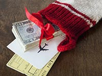 Christmas stocking with airline tickets and cash - Frommers: Holiday Flight Tips