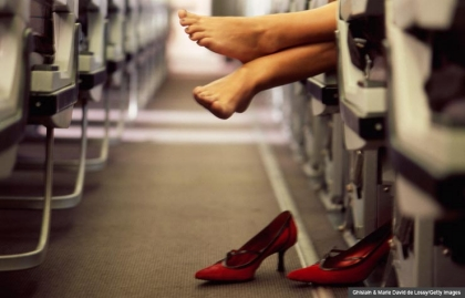 bare feet barefeet smell flight aisle heels kicked off airplane flight