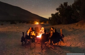 Campers hover by a toasty campfire under the stars at Anza-Borrego Desert (Dennis Mammana/dennismammana.com)