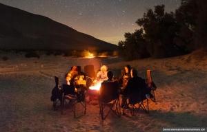 Campers hover by a toasty campfire under the stars at Anza-Borrego Desert (Dennis Mammana/dennismammana.com)