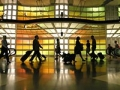 Travelers walking in an airport. 10 best holiday travel tips. (Alamy)