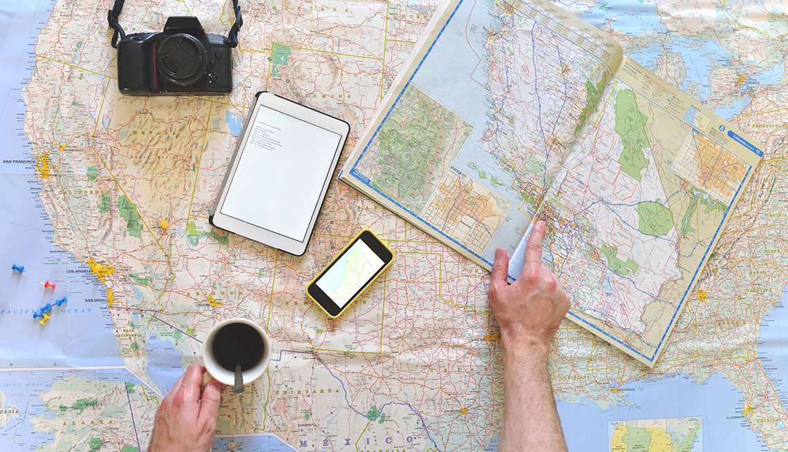 Man Looking at Maps and Using Electronic Devices, Road Trip Planning Apps, Travel
