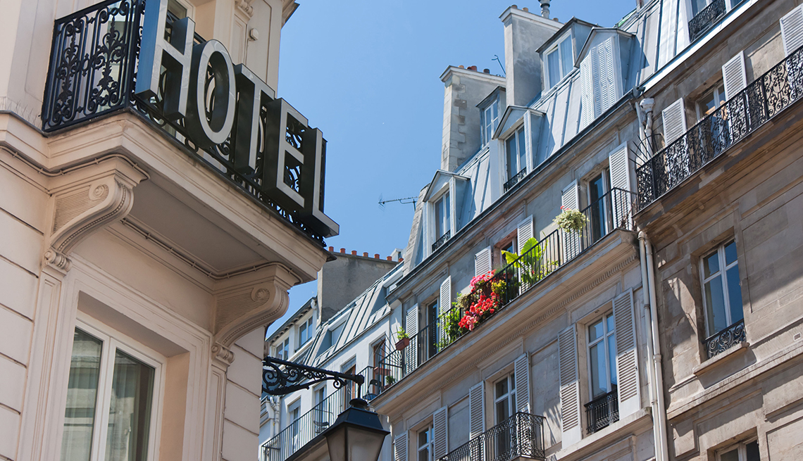 Hotel Sign on Buildings in Paris, Tips for Stretching Your Hotel Dollars