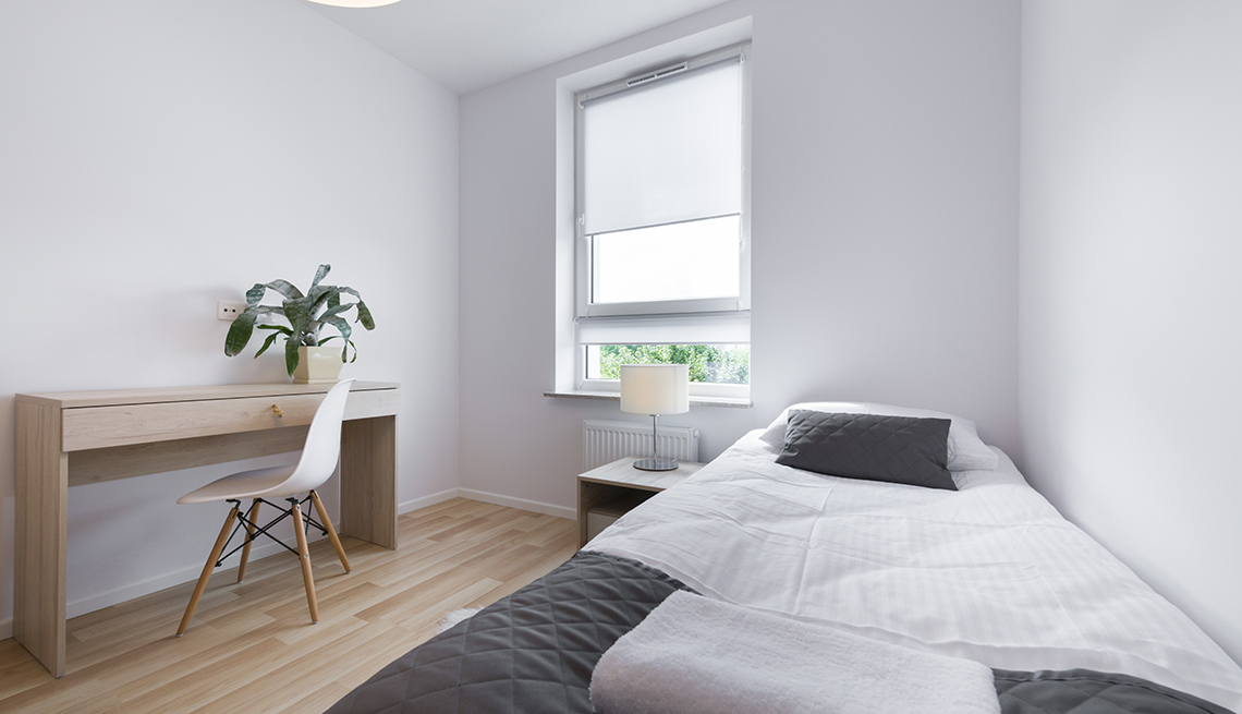Modern White Hotel Room with Bed, Desk and Chair, Tips for Stretching Your Hotel Dollars