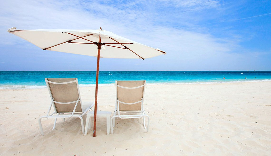 Beach Chairs And Umbrella On The Beaches In Cancun Mexico, Best Honeymoon Destinations