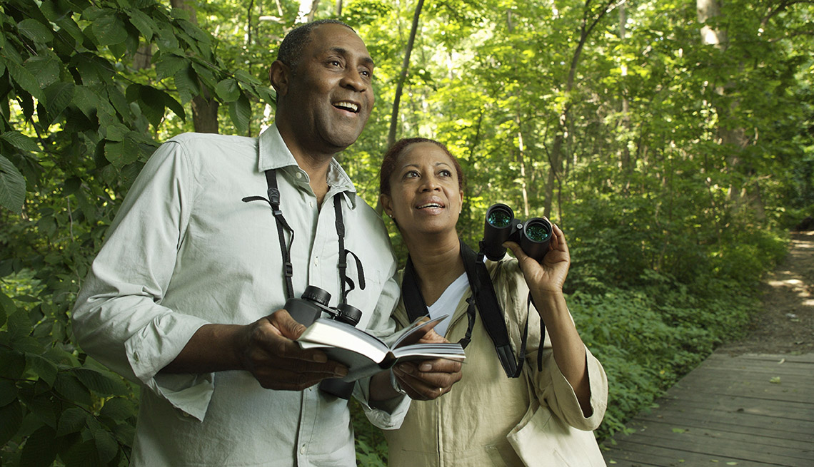 African American Couple With Binoculars Go Bird Watching, Unique Summer Vacation Ideas