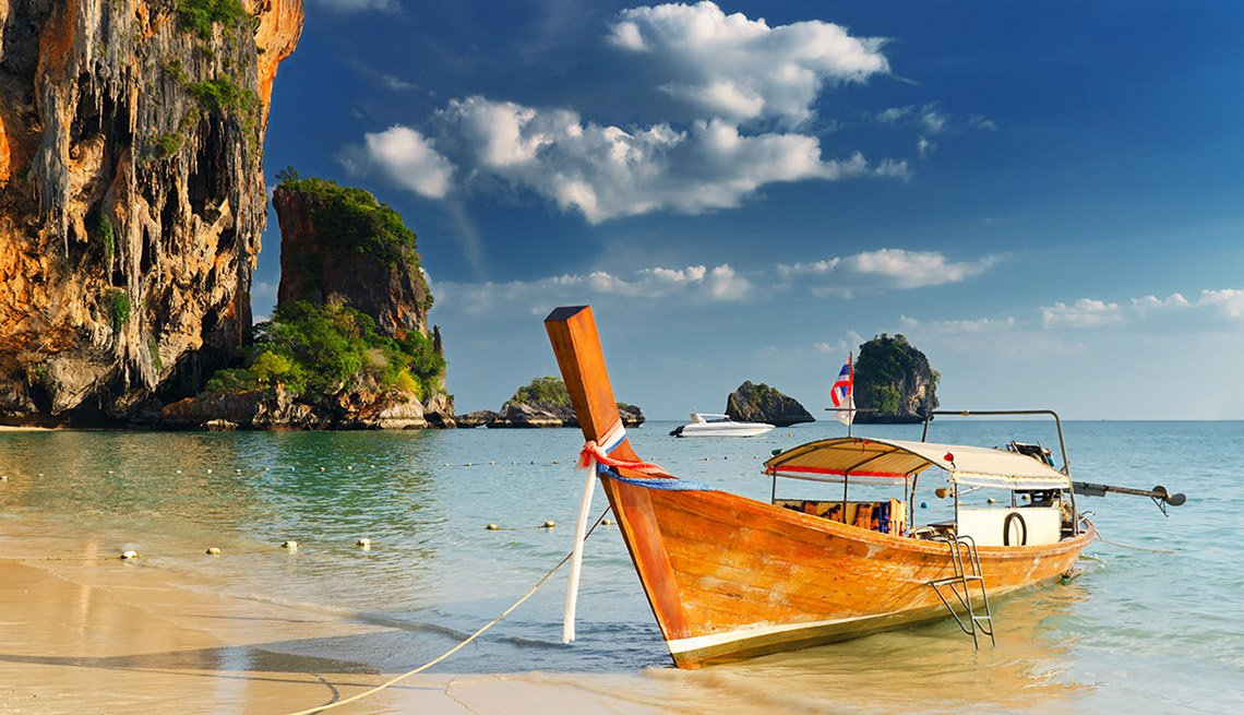 A Boat Moored Near The Beach In Thailand, Best Honeymoon Destinations