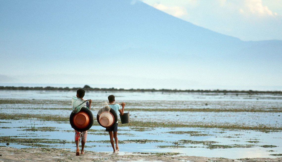Young Local Boys On The Beach In Bali Indonesia, Best Honeymoon Destinations