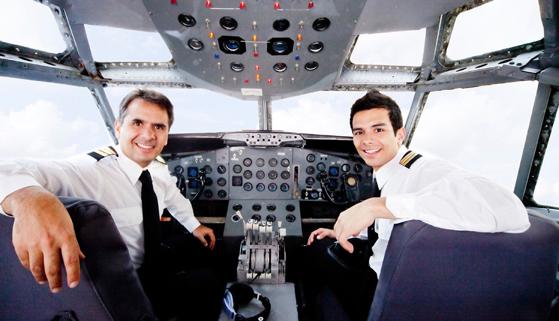Pilots In The Cockpit Of An Airplane, Airline Freebies