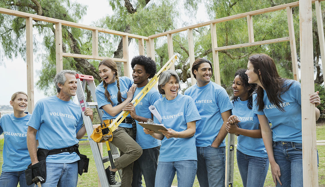 Volunteers Participating In Community Service Build A House Together, Unique Summer Vacation Ideas