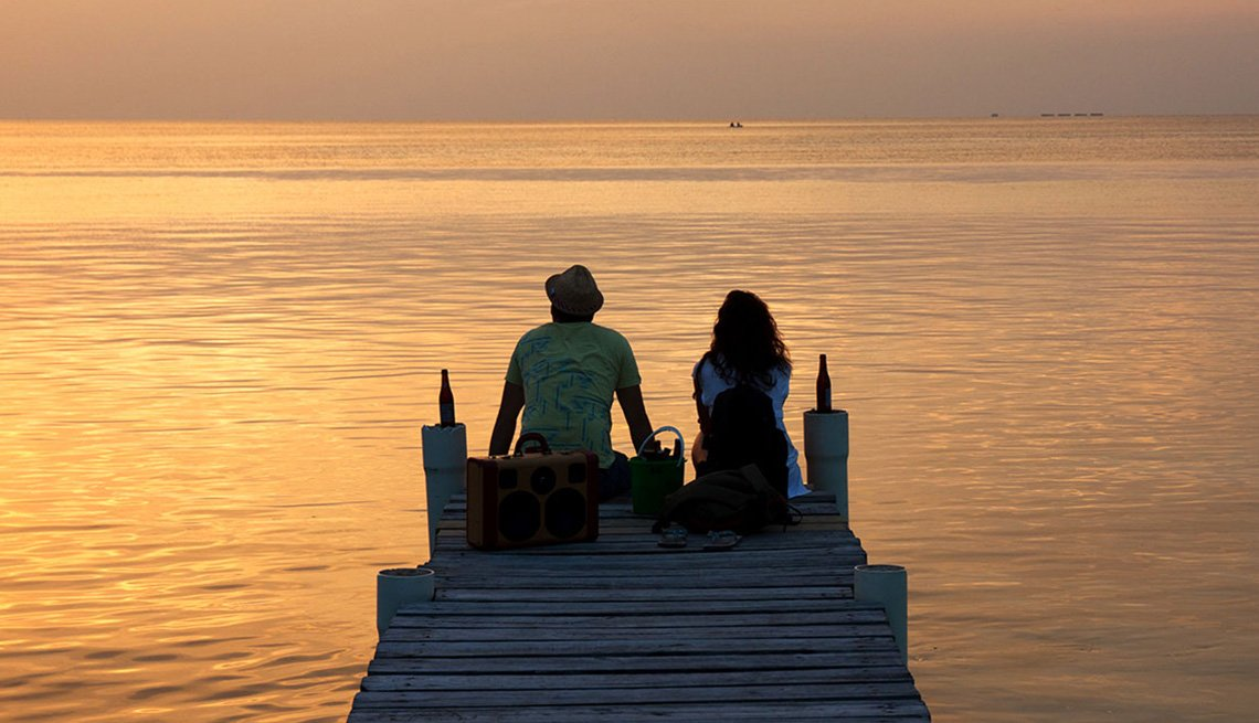 Couple Watch The Sunset On Dock In Belize, Best Honeymoon Destinations