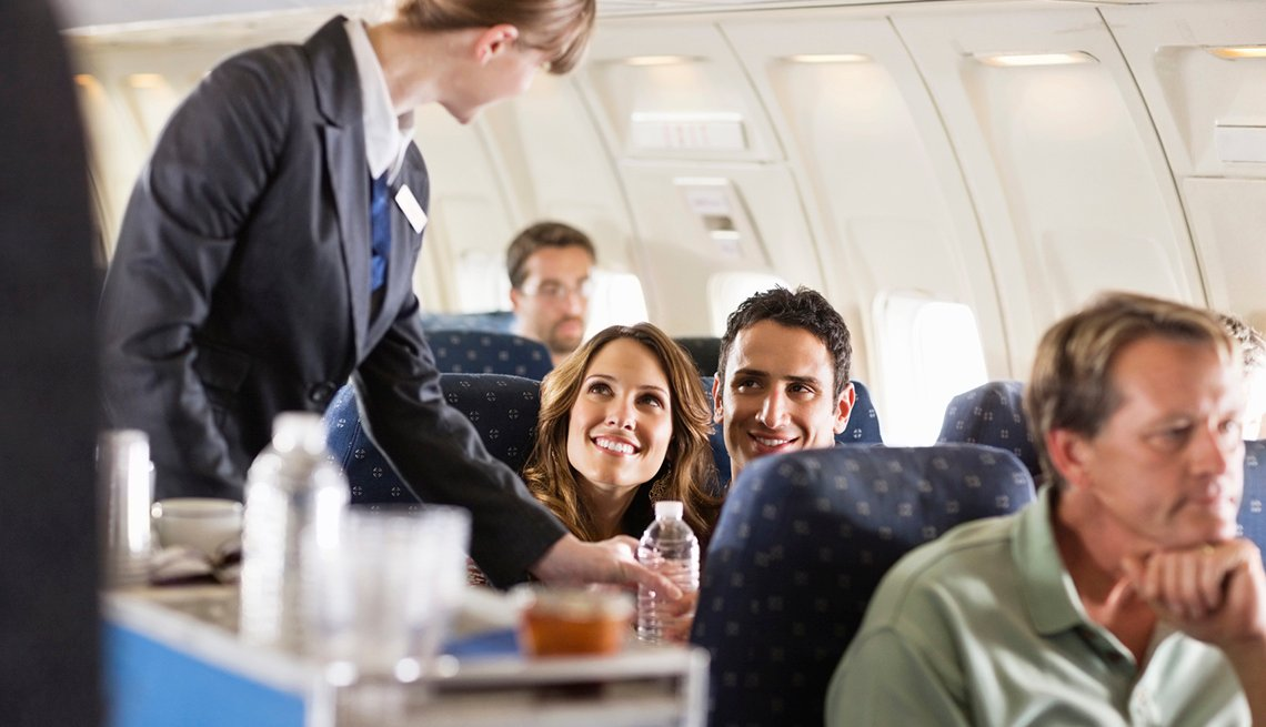 Couple Smiles At Flight Attendant, Airline Freebies