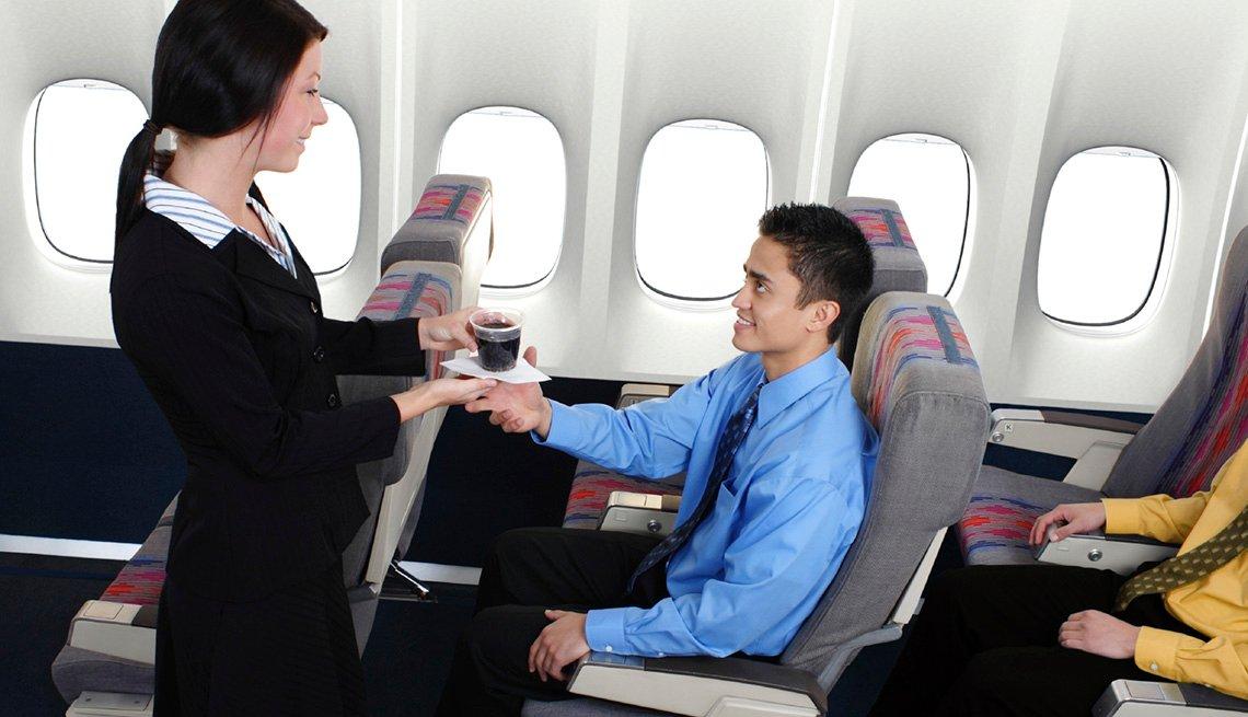 Flight Attendant Hands Soda To Passenger, Airline Freebies