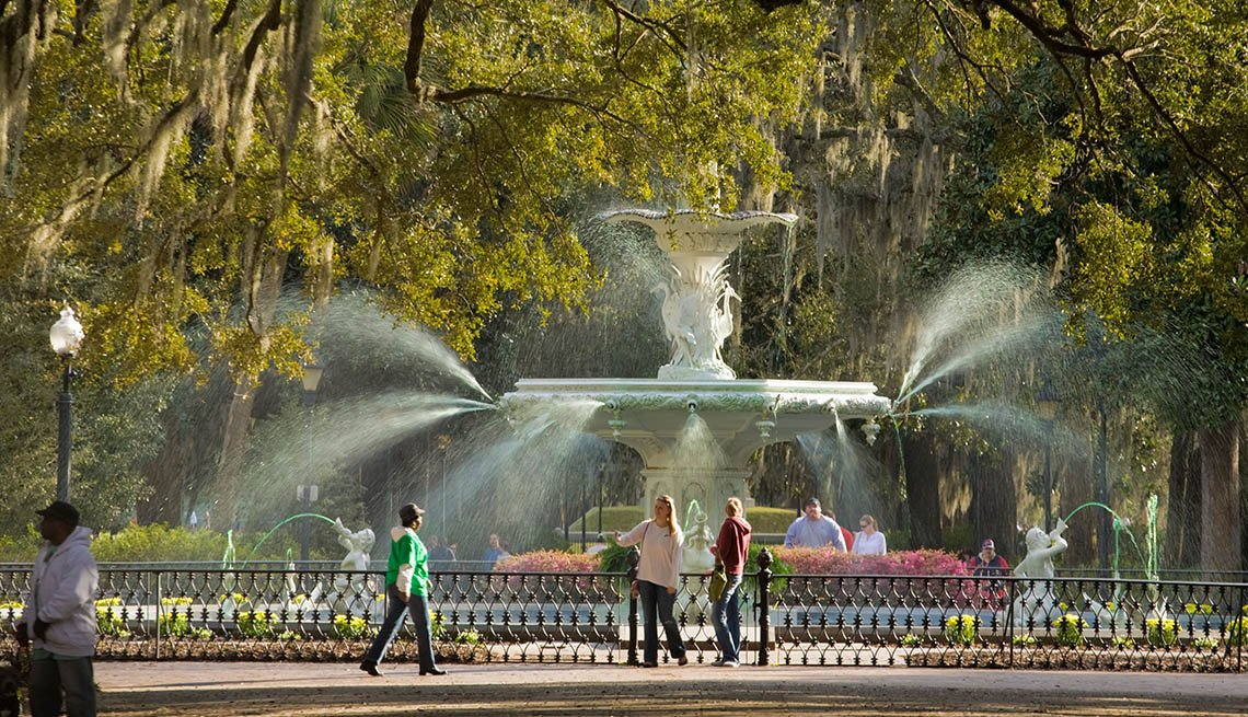 Tourists Enjoy A Fountain In A Park In Savannah Georgia USA, Save On Solo Travel