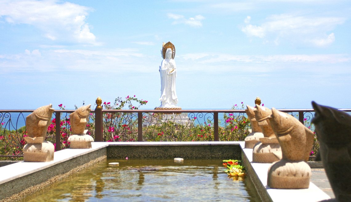 Fountain And Statue Overlook The View And Ocean In Hainan Island In China, Under The Radar Destiantions