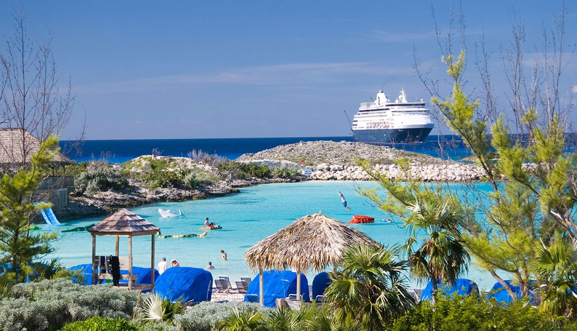 Half Moon Cay With Cruise Ship In Background In The Bahamas, Private Islands For Cruise Ship Passengers
