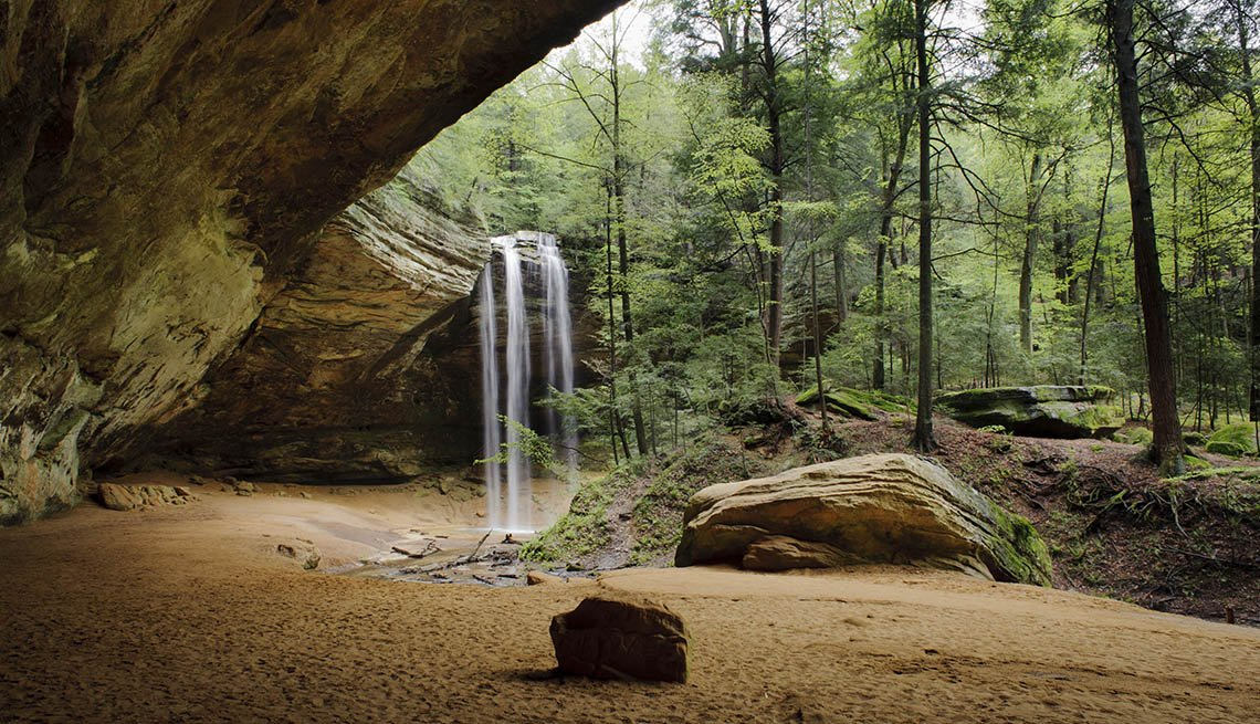 Waterfall By Cave Entrance in Hocking Hills State Park In Ohio USA, Under The Radar Destinations