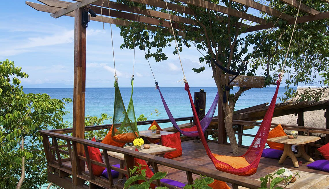 View Of Patio With Hammocks Overlooking The Ocean In Koh Lipe Thailand, Under The Radar Destinations