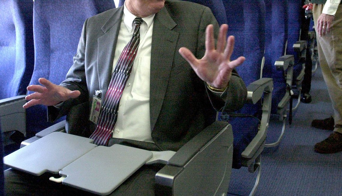Close Up Of A Passenger On Flight With His Hands In The Air In Disgust, Airline Freebies