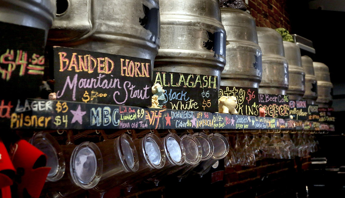 item 3 of Gallery image - Close Of A Bar Shelf Filled With Beer Kegs, Unique Fall Vacation Destinations
