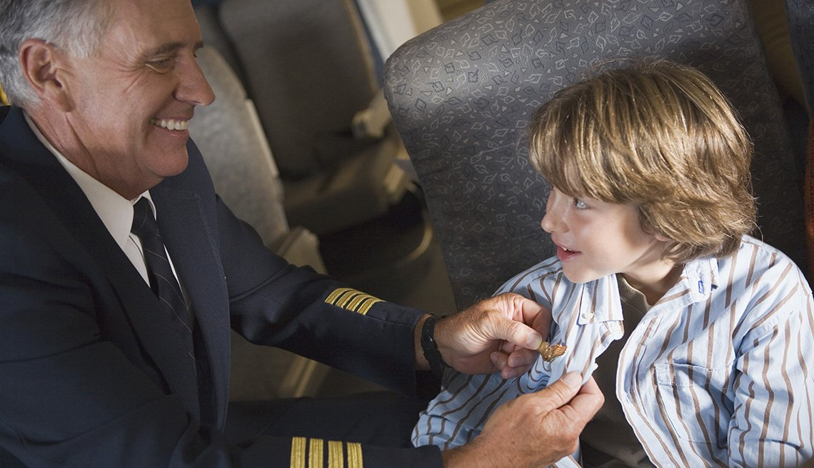 Airline Pilot Clips His Pilot Wings To Boy's Shirt, Airline Freebies