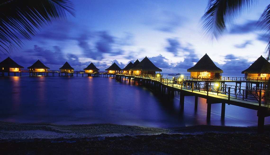Night Time At A Resort In Rangiroa Atoll In French Polynesia With Bungalows Over The Water, Under The Radar Destinations