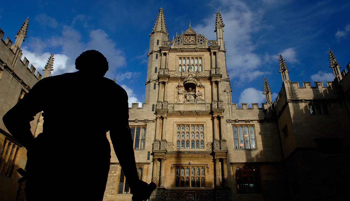 Statue In Foreground With Oxford University In Background Englad, United Kingdom, Unique Summer Vacation Ideas