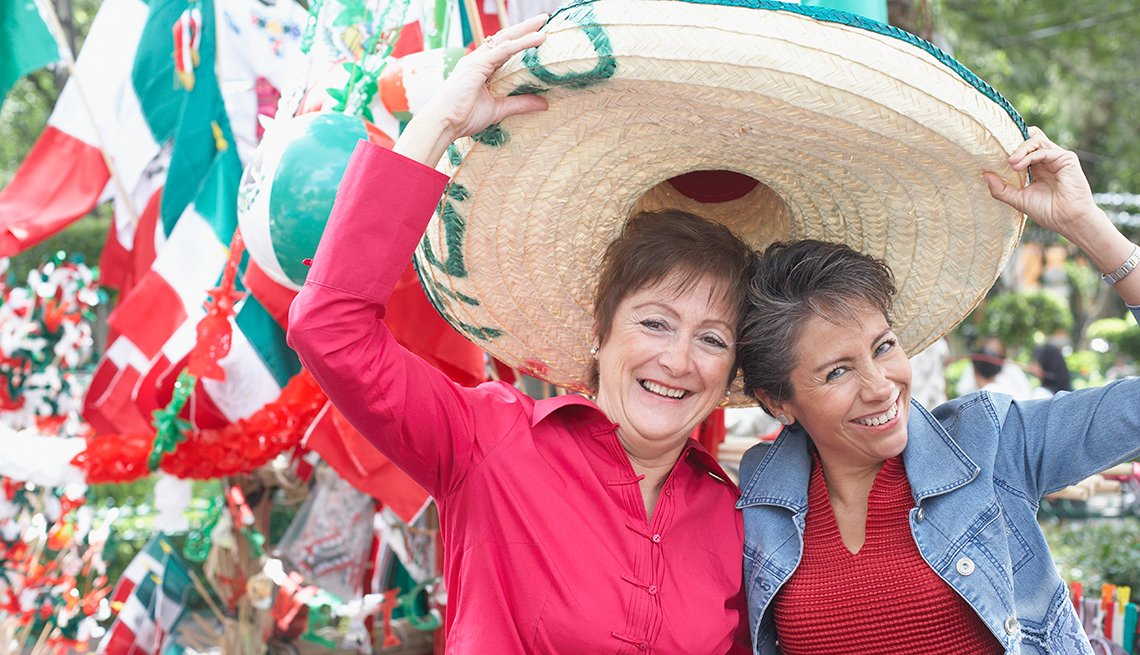 Mature Women Trying on Sombrero, Travel Safely in Mexico