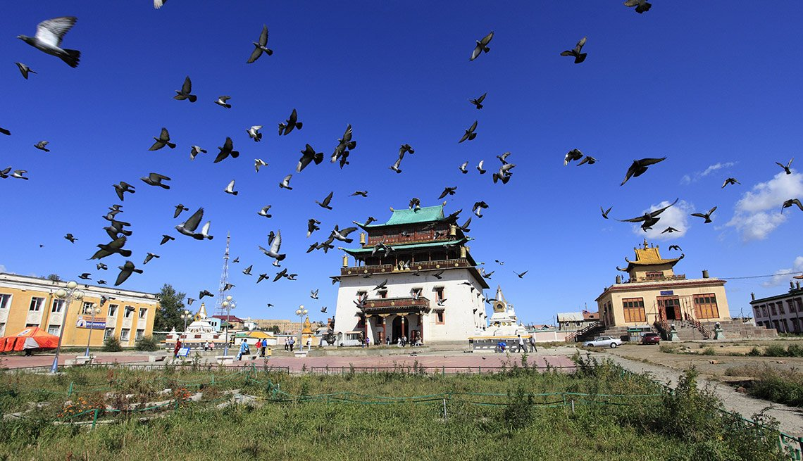 Temple And Birds Flying High Above In The Sky At Ulan Bator In Mongolia, Under The Radar Destinations